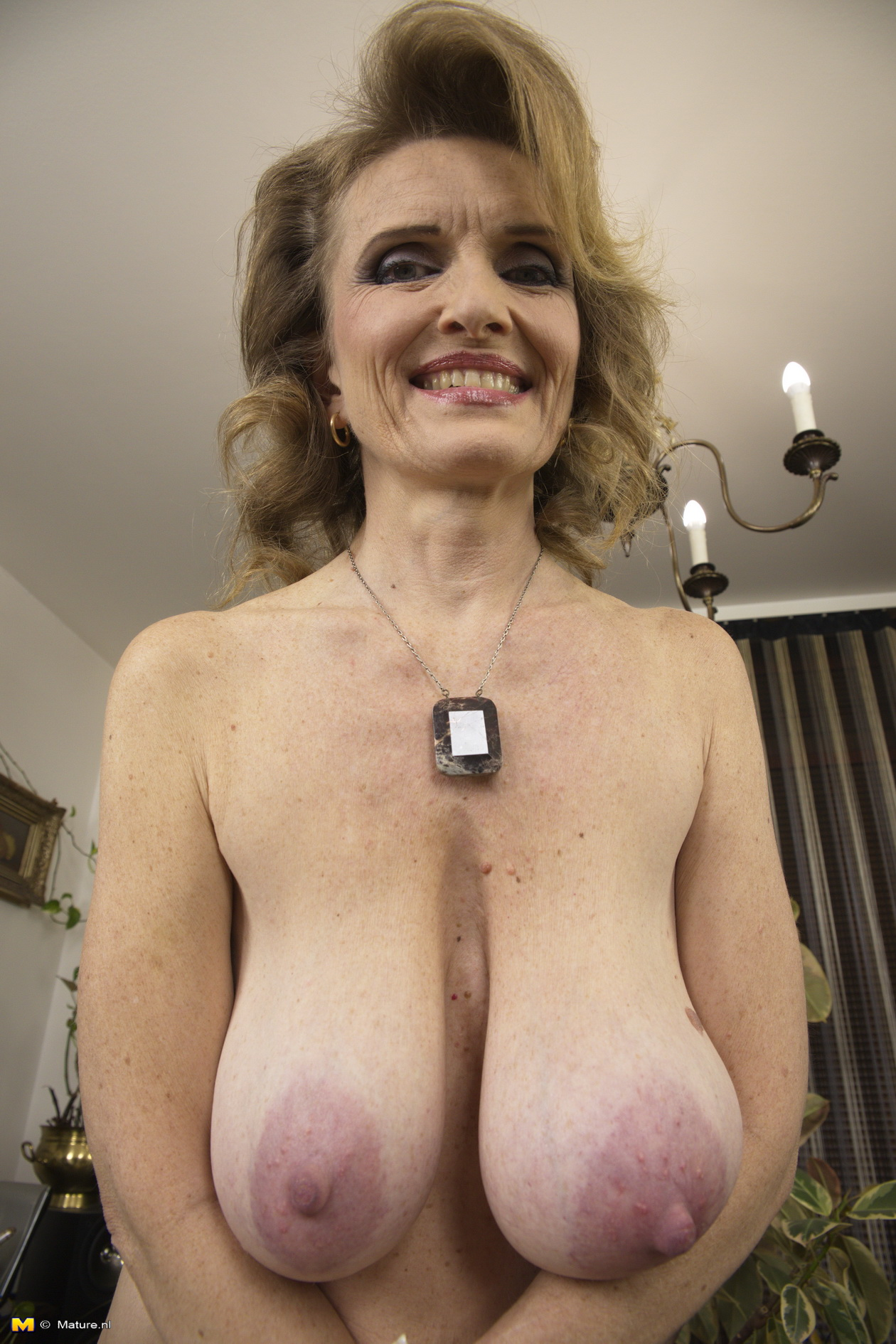 big breasted mature lady playing alone