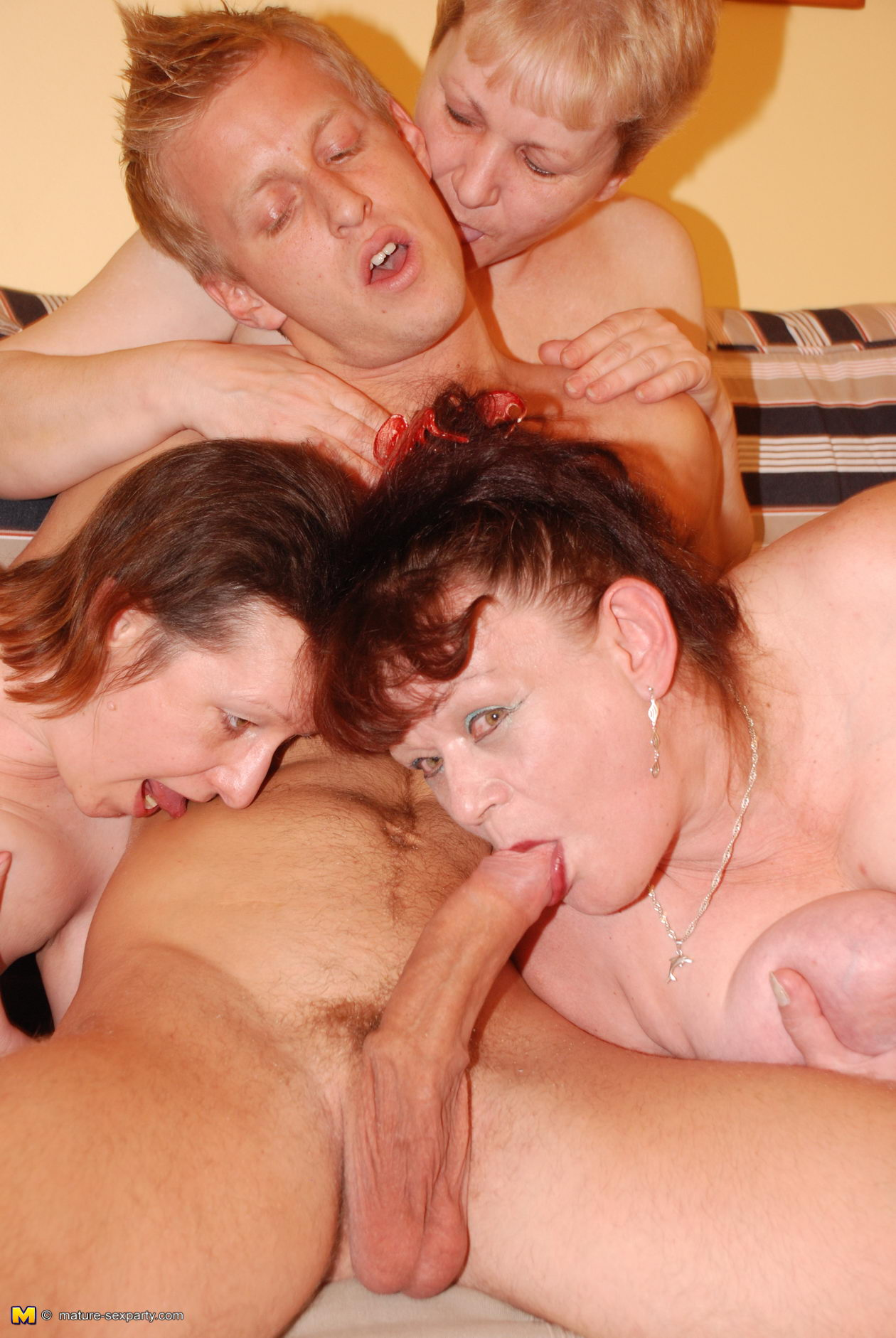 Horny mature with three cocks