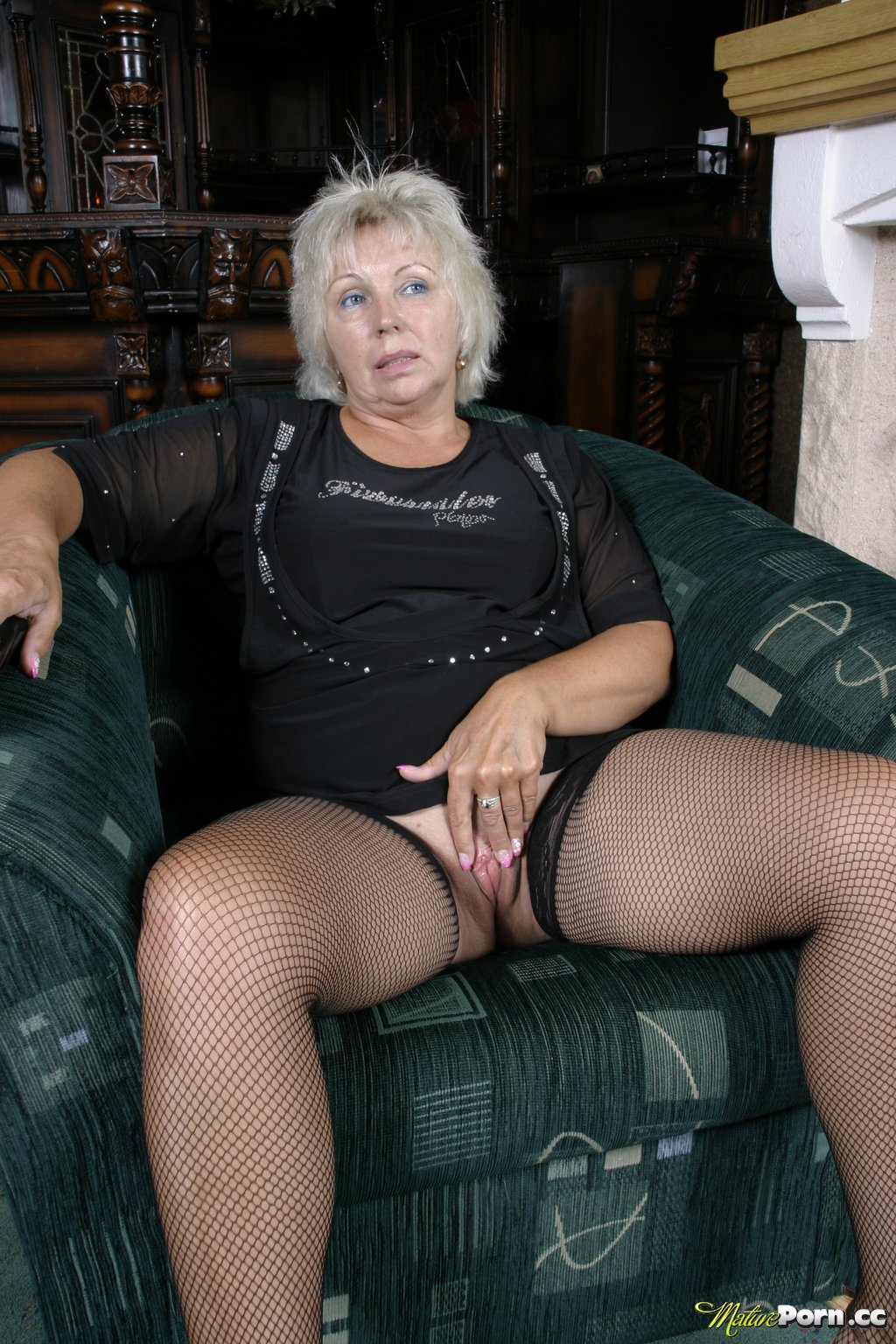 granny in fishnets toying her shaved pussy