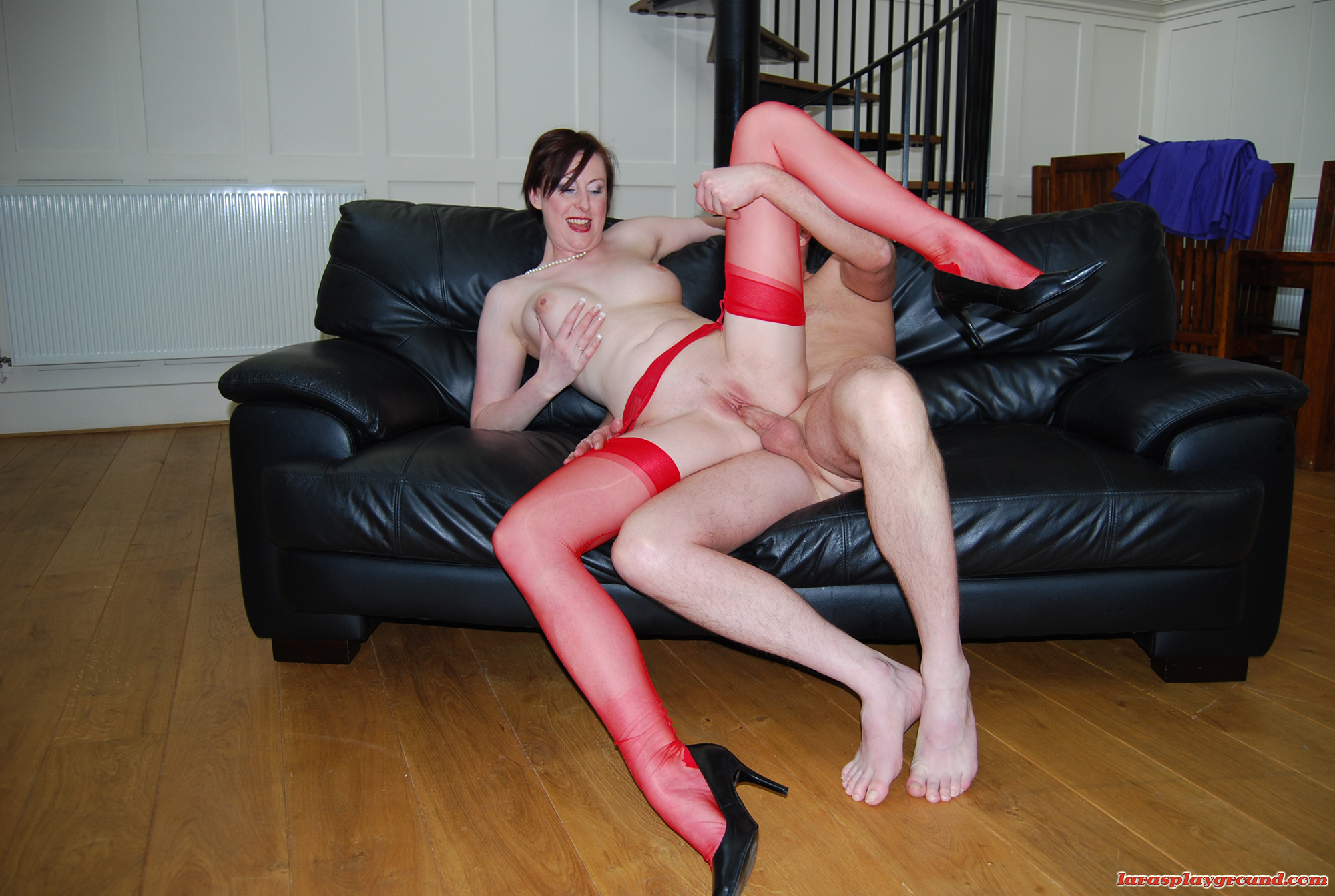 sexy milf in red seamed stockings fucking a lucky fan